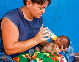 Baby Dixon receives his first bottle from Brenda