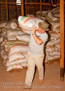 Our team member, Dave Vander Griend, carries 160 lb. bag of corn