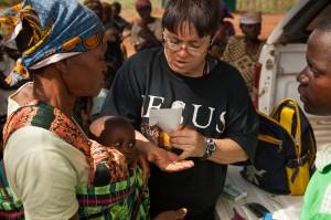 Brenda giving the sick baby's vitamins.